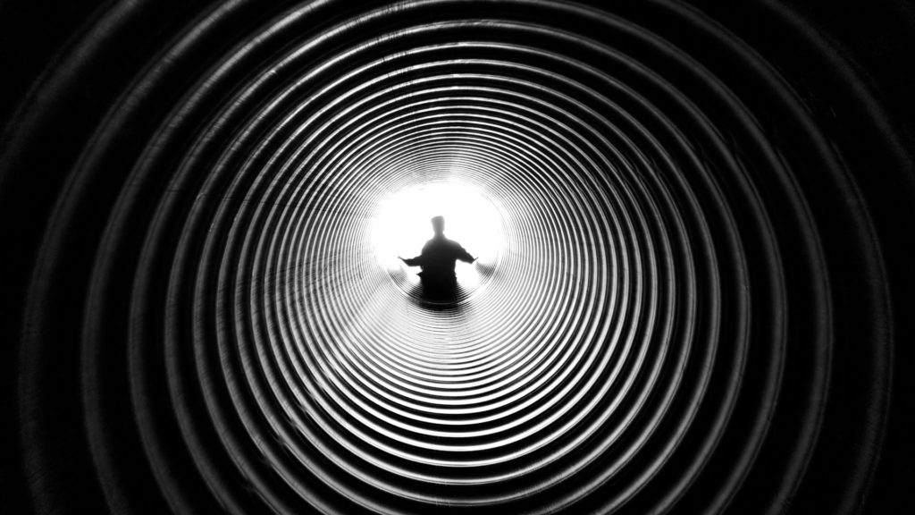 grayscale photography of person at the end of tunnel 211816 1024x576 - Clarity is the Currency Your Business Needs For Traction.